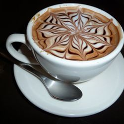 """<b>Cafe Mocha</b>: Same as a latte, but with a little bit of chocolate. <br />(<a href=""""http://upnorthfoodies.com/archive/cuppa_joe_latte_art_during_tc_art_walk/"""" rel=""""nofollow"""">Photo</a>)"""