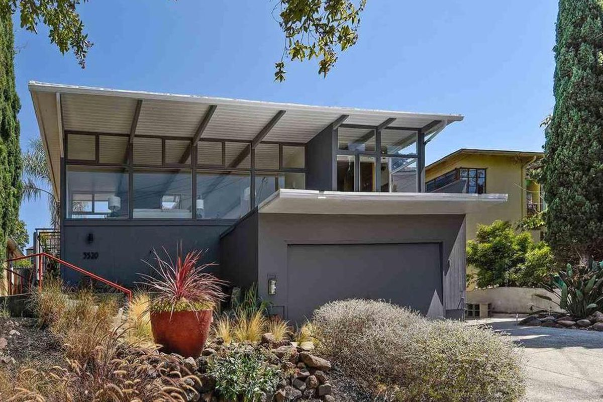 Midcentury home exterior, front, gray.