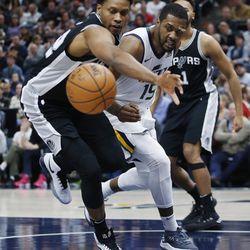 Utah Jazz forward Derrick Favors and San Antonio Spurs forward Kawhi Leonard (2) fight for the rebound in Salt Lake City on Thursday, Dec. 21, 2017.