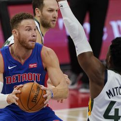 Detroit Pistons forward Blake Griffin (23) looks to pass as Utah Jazz guard Donovan Mitchell (45) defends during the second half of an NBA basketball game, Sunday, Jan. 10, 2021, in Detroit.