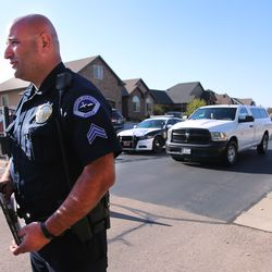 South Jordan Police Sgt. Sam Winkler, talks with media as the medical examiner's truck departs with the body of 35-year-old Ashley Sorenson, whose body was found in a home in a gated community on the 10200 South block of Jordan Creek Drive on Monday, April 20, 2020.