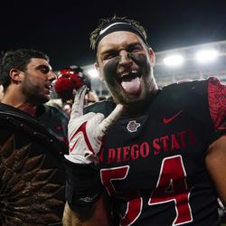 San Diego State linebacker Caden McDonald (54) celebrates after a 33-31 win in triple overtime against Utah in an NCAA college football game Saturday, Sept. 18, 2021, in Carson, Calif.