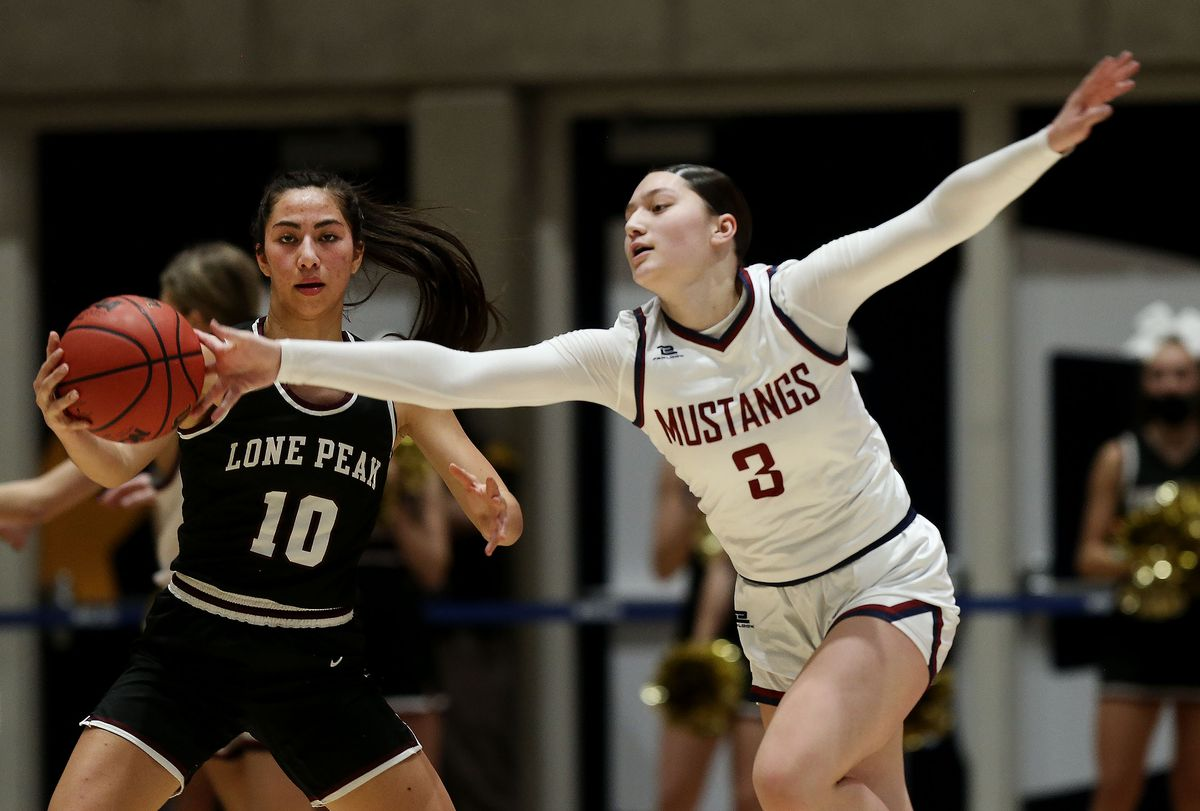 Herriman's Lealani Falatea (3) steals the ball from Lone Peak's Teuila Nawahine (10) during the 6A girls basketball state semifinals at Salt Lake Community College in Salt Lake City on Thursday, March 4, 2021. Herriman won 54-46.