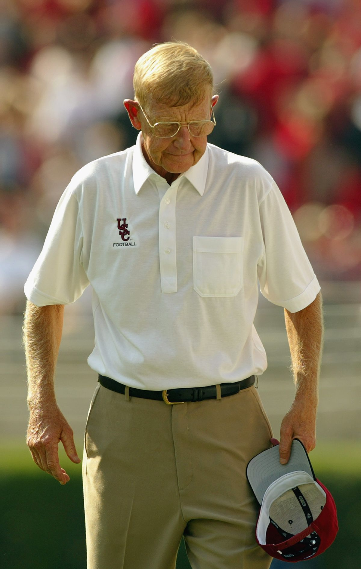 Lou Holtz owers his head
