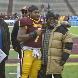 Michael Oliver poses with family during Senior Day ceremonies.