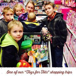 """The Stapley family helps pick out toys for a Toys for Tots shopping trip. The family owns the business """"Santa's Red Letter,"""" a service that provides personalized letters to children from Santa. A dollar from every letter is donated to Toys for Tots."""
