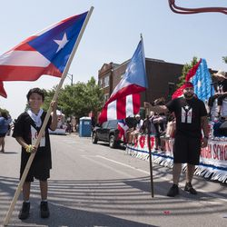 Hector Rios Jr. 10, and William Ayala next to the Dr. Pedro Aldizu Campos High School float. | Rick Majewski/For the Sun-Times.