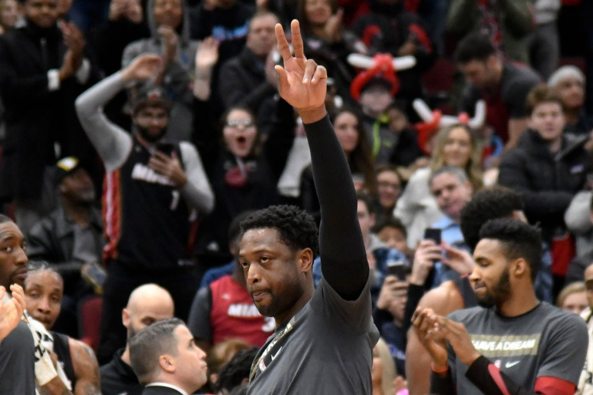 Dwyane Wade gestures to the crowd
