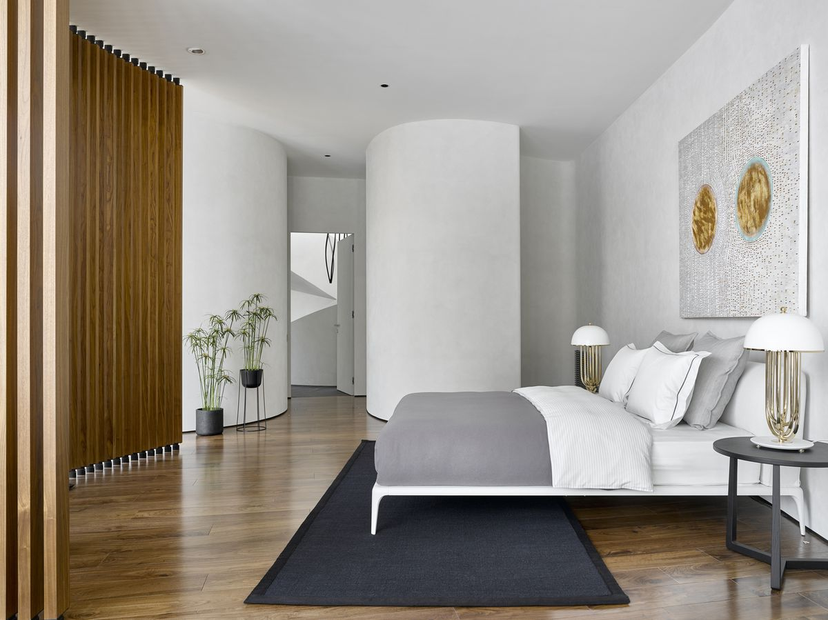 Bedroom with wood floors and modern furniture.
