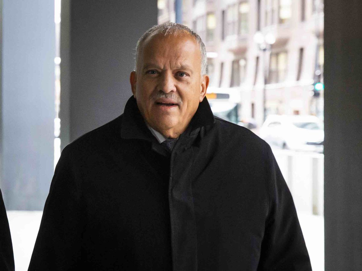 Ex-State Rep. Luis Arroyo walks into the Dirksen Federal Court Building Tuesday before he pleads not guilty to a bribery charge.