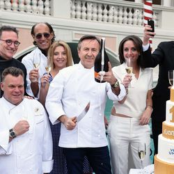 Daniel Boulud, center, successfully sabers off the cork from a bottle of champagne to kick off Vegas Uncork'd.