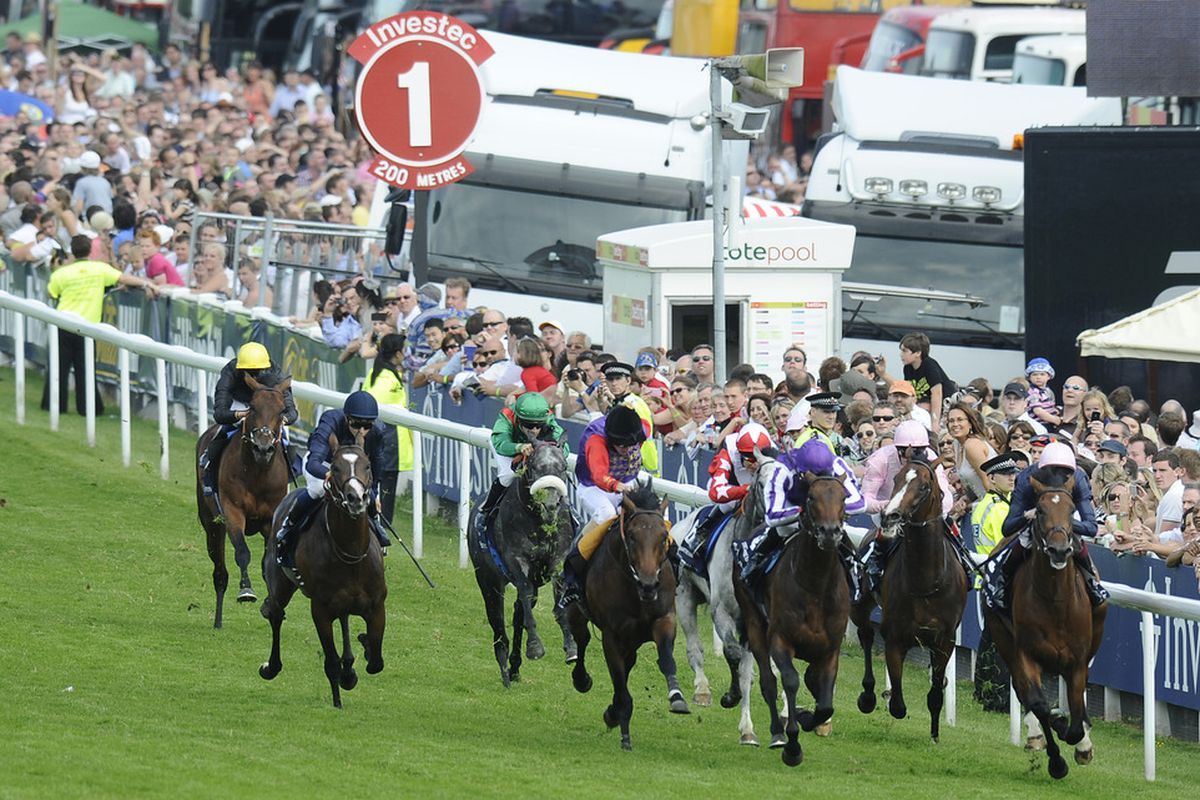 EPSOM, ENGLAND - JUNE 04:  Mickael Barzalona riding Pour Moi (2L, blue) challenge wide and late to win The Investec Derby during The Derby Festival at Epsom racecourse on June 04, 2011 in Epsom, England  (Photo by Alan Crowhurst/ Getty Images)