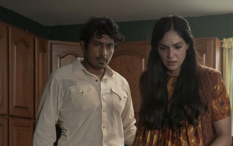 Ariana Guerra and Tenoch Huerta look appalled at a cardboard box in Madres