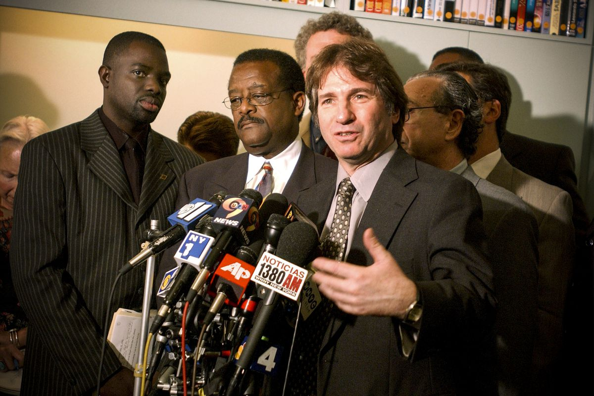Lawyer Barry Scheck speaks to reporters  on July 12, 2001, after New York City and its police union agreed to pay almost $9 million to settle Abner Louima's civil lawsuit over police abuse.