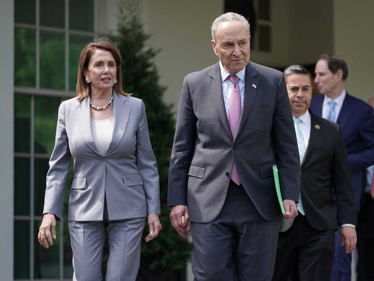 Speaker of the House Nancy Pelosi and Senate Minority Leader Chuck Schumer lead fellow congressional Democrats out of the White House following a meeting with President Donald Trump on infrastructure.