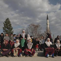 In this Wednesday March 28, 2012 photo Bulgarian Muslims gather on the square during commemoration ceremony for the victims of the communist repression,  39 years ago, in Breznitsa, some 10 km from the village of Kornitsa, Bulgaria. On March 28, 1973 police and army units stormed the village of Kornitsa and opened fire on hundreds at people gathered in the square to protest the communist regime's campaign to force Bulgaria's Muslims to adopt non-Islamic names and break up their communities. The brutal crackdown left five men dead and more than 100 wounded. More than 70 families were forced to leave their homes and settle in remote villages.
