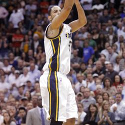 Utah Jazz guard Devin Harris (5) hits a three point shot with 37.9 seconds left in overtime giving the Jazz a 115-107 lead as the Utah Jazz and the Orlando Magic play Saturday, April 21, 2012 in Energy Solutions arena. Jazz won 117-107.
