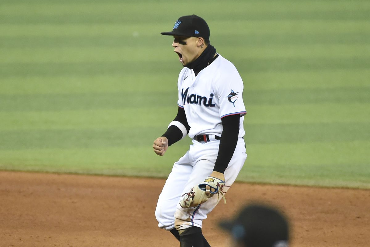 Isan Diaz #1 of the Miami Marlins reacts after a safe call at first base while trying to turn a double play during the ninth inning against the Philadelphia Phillies at loanDepot park