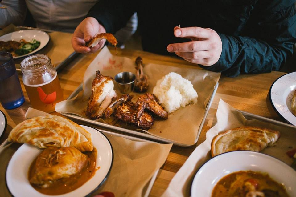 Pictures of several trays of chicken, curry, and roti at Hat Yai, with a pair of hands holding ripped pieces of roti