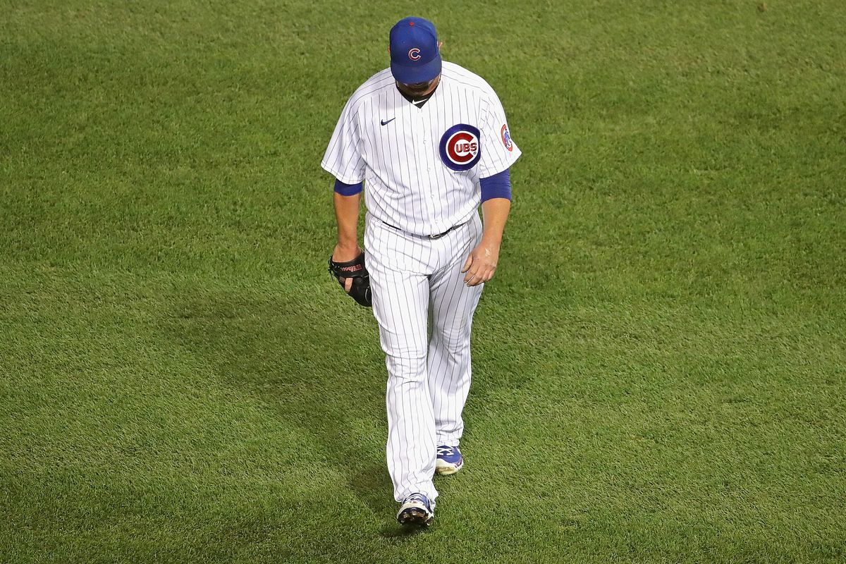 Cubs starter Jon Lester walks to the dugout after being taken out of the game Friday.