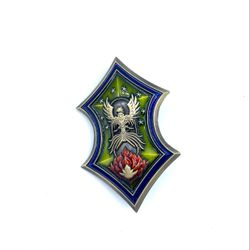 The Council of Tal'Dorei badge.