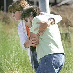 Vickie Proctor, left, a victims assistant with Provo city, consoles a mother of one of the four victims shortly after they were informed about the fates of the young hikers.