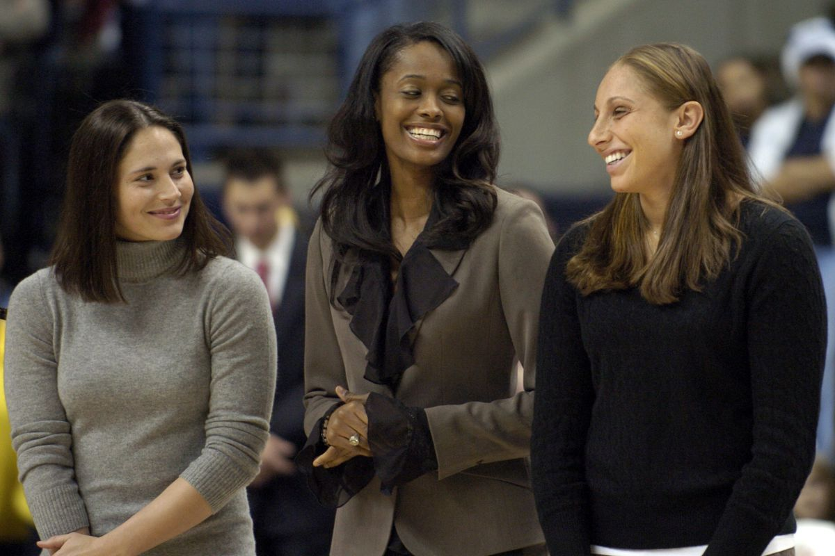 Former University of Connecticut women's basketball players Sue Bird, left, Swin Cash, center, and Diana Taurasi share a light moment during the Huskies of Honor induction ceremony at Gampel Pavillion in Storrs, Conn., Thursday, Dec. 21, 2006. Ten First T