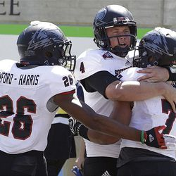 Southern Utah's Henna Brown (7) is congratulated by quarterback Brad Sorensen (4) and Myles Crawford-Harris (26) after Brown scored against California during the second half of an NCAA college football game Saturday, Sept. 8, 2012, in Berkeley, Calif. (AP Photo/Ben Margot)