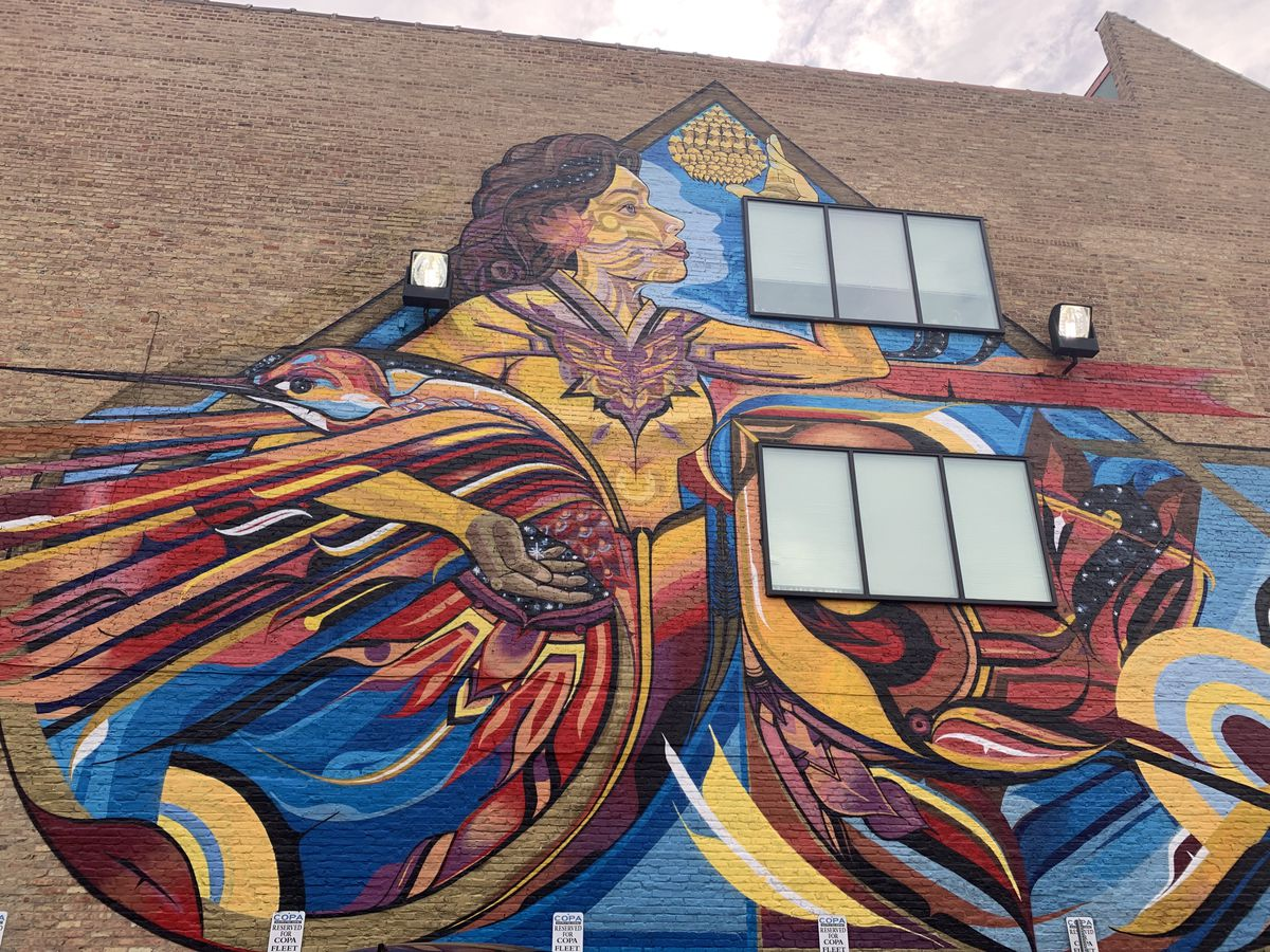 """Miguel Del Real's three-story mural """"Embracing Life,"""" painted in 2018 on a former Goldblatt's department store near Chicago and Ashland avenues."""