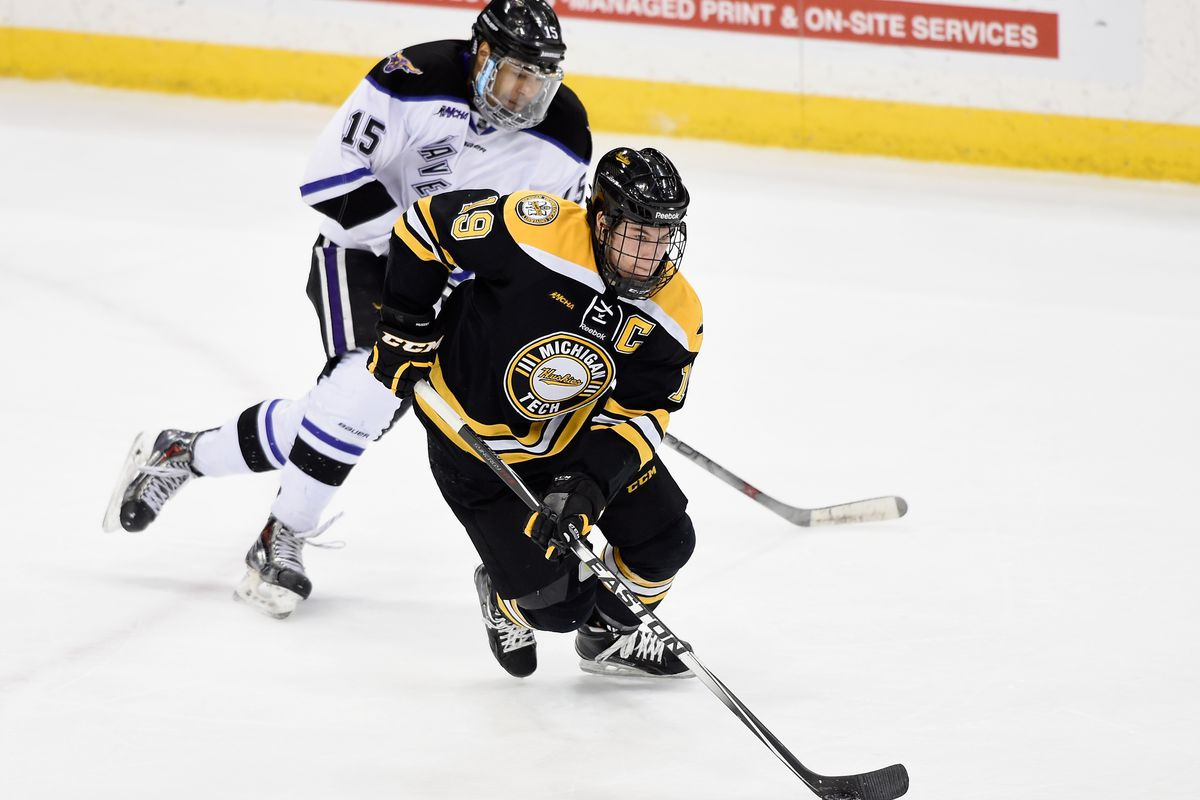 Blake Pietila #19 of Michigan Tech controls the puck against C.J. Franklin #15 of Minnesota State during the third period of the 2015 WCHA Final Five hockey championship game on March 21, 2015 at Xcel Energy Center in St Paul, Minnesota.