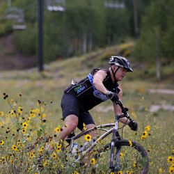 A mountain biker rides down Park City Mountain Resort in Park City on Friday, Sept. 5, 2014.