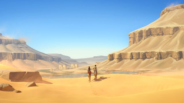 Two figures stand in an Egyptian desert valley beneath a blue sky in a screenshot from In the Valley of Gods.