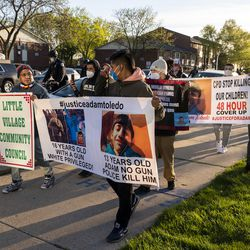 Activists march away from the Chicago Police Training Academy towards the Fraternal Order of Police Lodge, Friday, April 30, 2021.