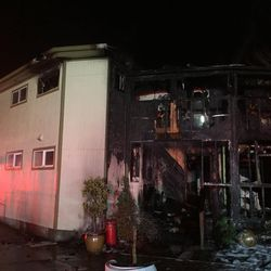 This photo provided by Bellevue, Wash., Fire Department shows damage to the Islamic Center of the Eastside after a fire  in Bellevue, Wash., on Saturday, Jan. 14, 2017. Police say a man is in custody after a suspicious fire severely damaged the mosque overnight.  Authorities say that as firefighters doused the flames, police found a 37-year-old man near the building and arrested him for investigation of arson. Police spokesman Seth Tyler says investigators believe the man is the sole suspect. The mosque was unoccupied at the time and no injuries were reported.