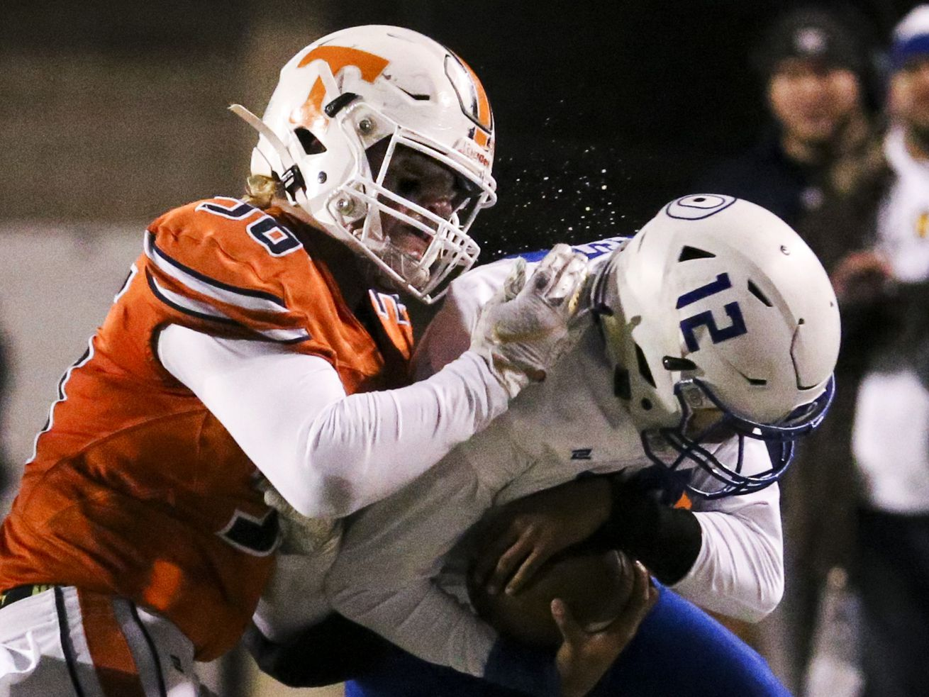 Timpview Thunderbirds defensive end Cael Richardson (36) collides with Orem Tigers quarterback Micah Fe'a (12) shoving him out of bounds during the first half of the 5A state high school football game at Rice-Eccles Stadium in Salt Lake City on Friday, Nov. 22, 2019.
