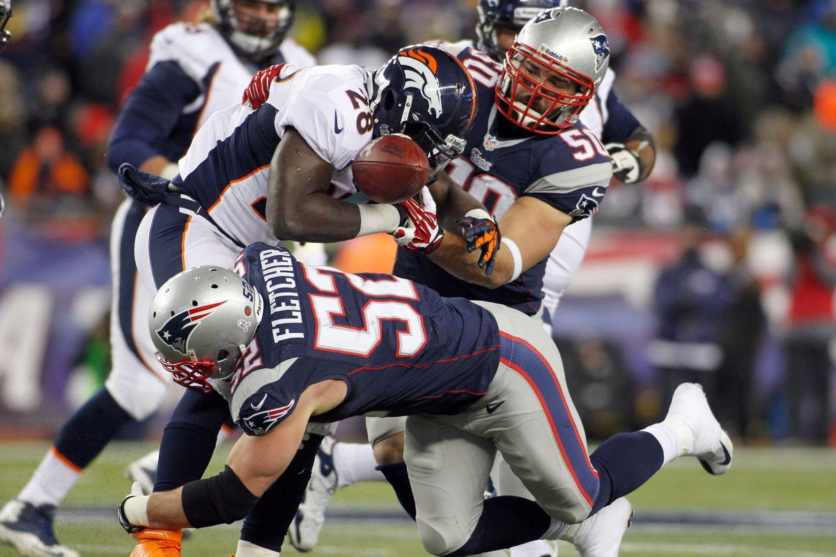 Dane Fletcher and Rob Ninkovich help to separate the Montee from the Ball.
