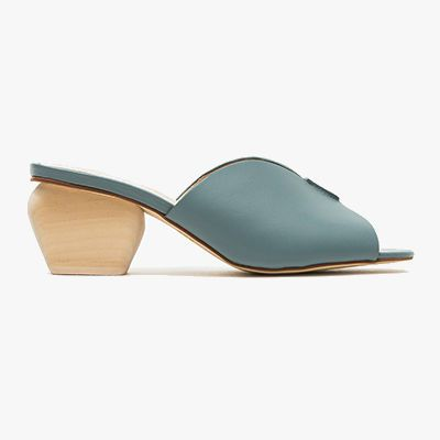 Baby blue mules with birch colored block heel.