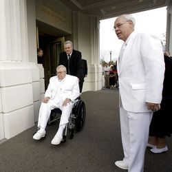 Elder Boyd K. Packer is assisted to the cornerstone at the Brigham City Temple prior to the dedication Sunday, Sept. 23, 2012.