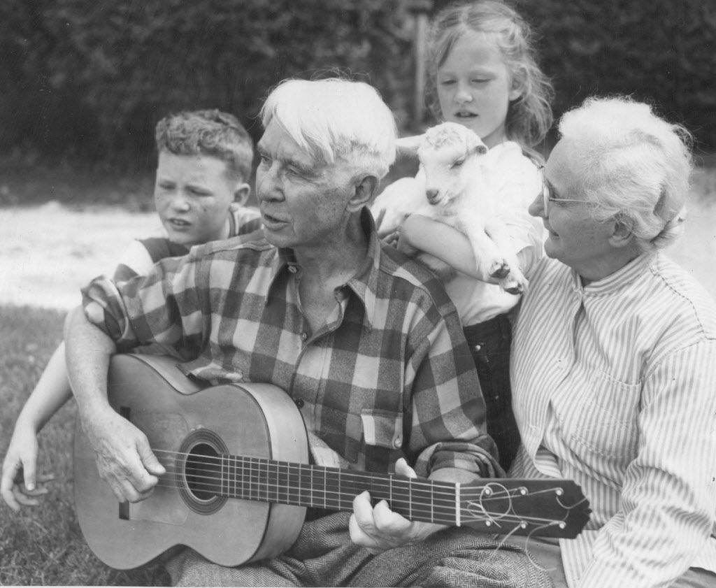 Carl Sandburg entertains his wife and grandchildren John, 9, and Karlen Thoman, 7, with his playing and singing of American ballads in 1951. Sun-Times File Photo.