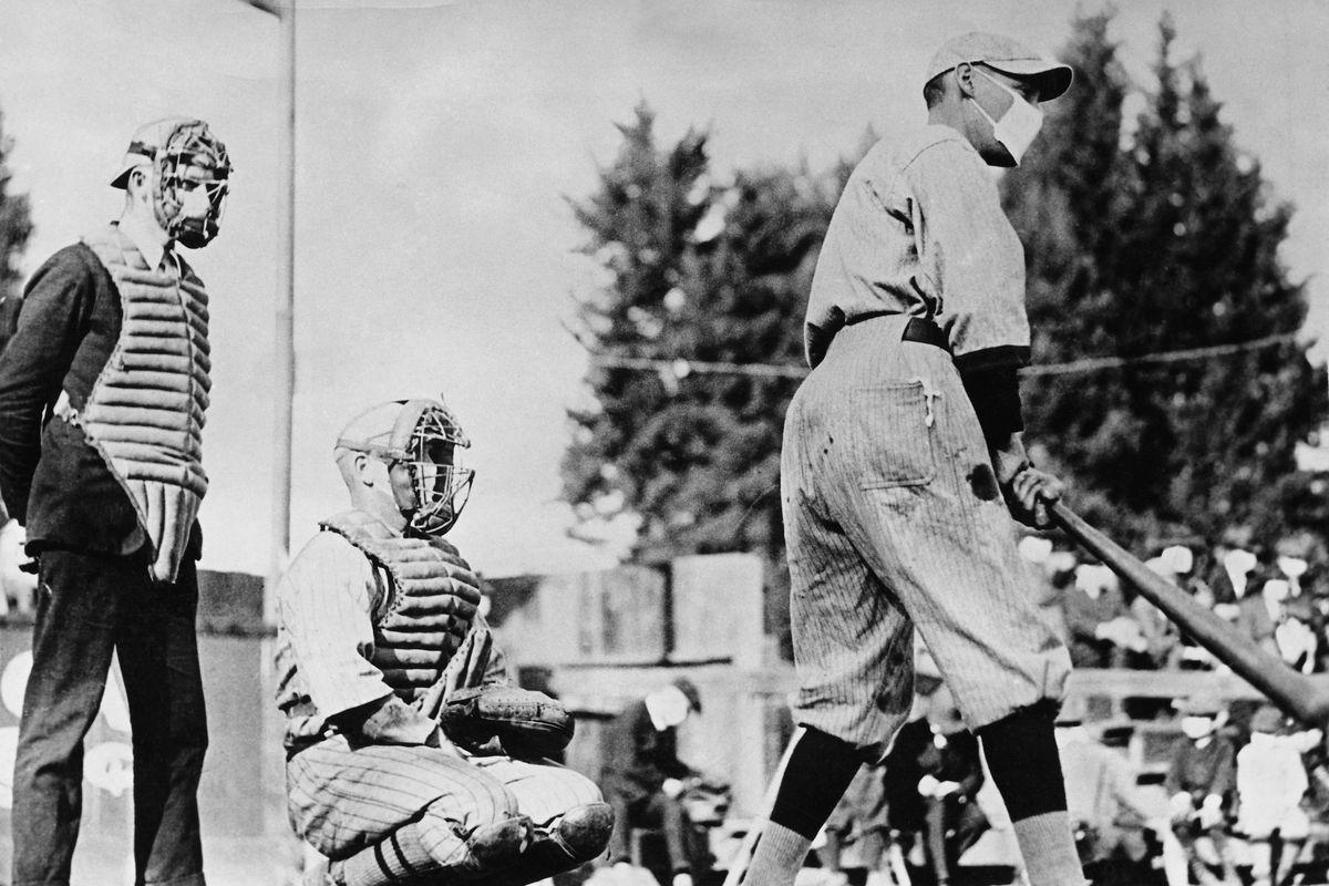 Baseball Player Wearing a Protective Mask