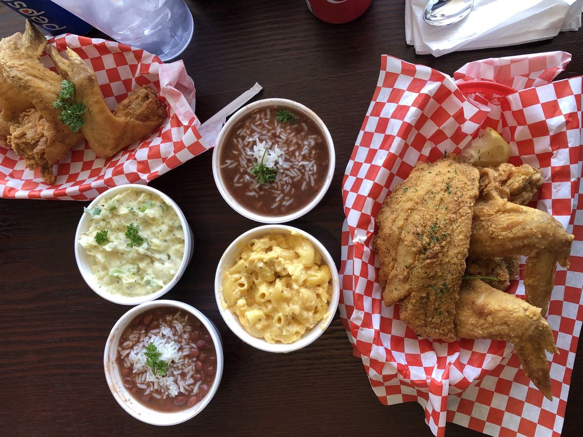 A spread of fried seafood and sides at Louisiana Heaven