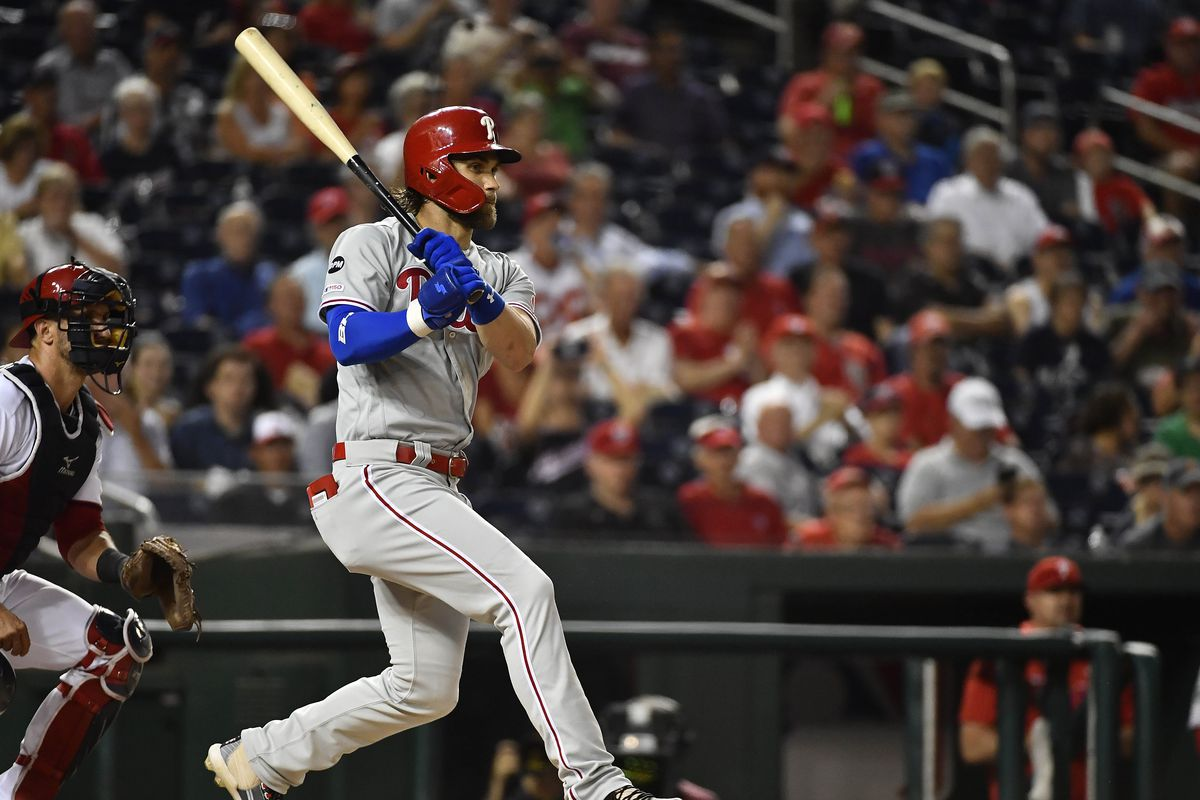 Philadelphia Phillies right fielder Bryce Harper hits a single against the Washington Nationals during the first inning at Nationals Park.