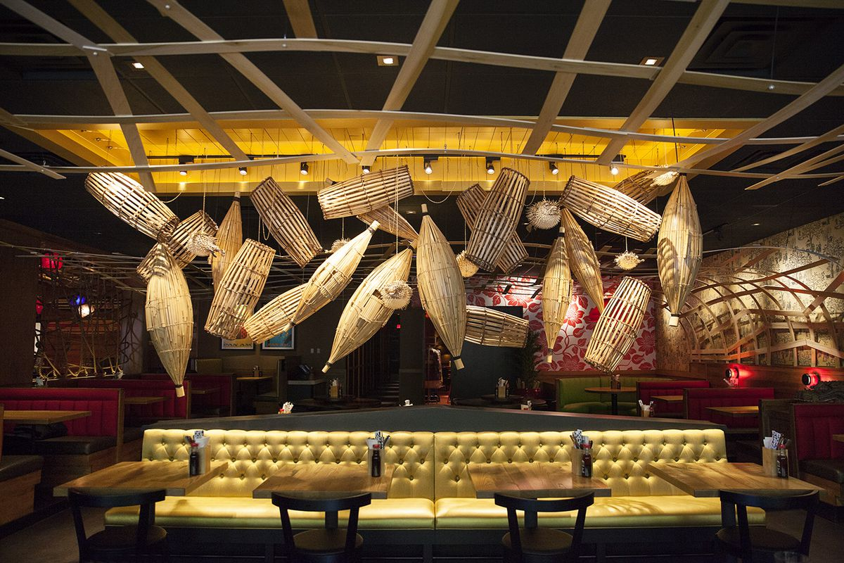 Gold booths underneath fishing baskets in the dining room