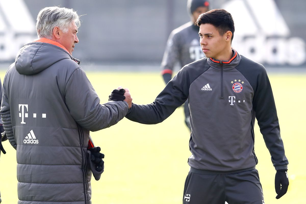 MUNICH, GERMANY - FEBRUARY 02: (EXCLUSIVE COVERAGE) Carlo Ancelotti, head coach of FC Bayern Muenchen shake hands with Raphael Obermair during a training session at Saebener Strasse training ground on February 2, 2017 in Munich, Germany.
