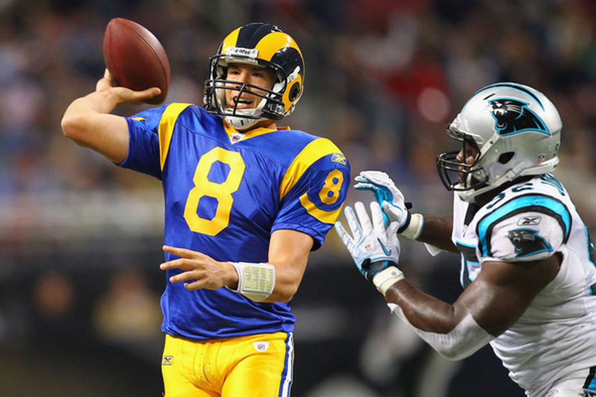 Sam Bradford #8 of the St. Louis Rams looks to pass to someone...anyone.