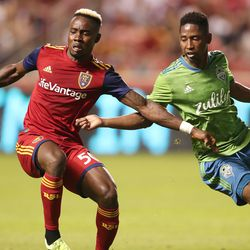 Real Salt Lake forward Sam Johnson (50) runs down the ball with Seattle Sounders defender Kelvin Leerdam (18) at his side as RSL and the Sounders play at Rio Tinto Stadium in Sandy, Utah, on Wednesday, Aug. 14, 2019.