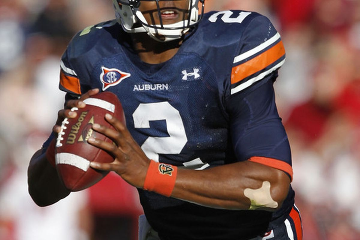 AUBURN AL - OCTOBER 16:  Quarterback Cam Newton #2 of the Auburn Tigers rolls out during the game against the Arkansas Razorbacks at Jordan-Hare Stadium on October 16 2010 in Auburn Alabama.  (Photo by Mike Zarrilli/Getty Images)