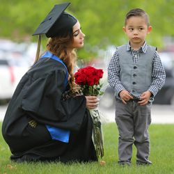 Jaritzy Rodriguez tries to talk her son, Julian, into taking a photo with her after Salt Lake Community College's commencement at the Maverik Center in West Valley City on Friday, May 6, 2016.