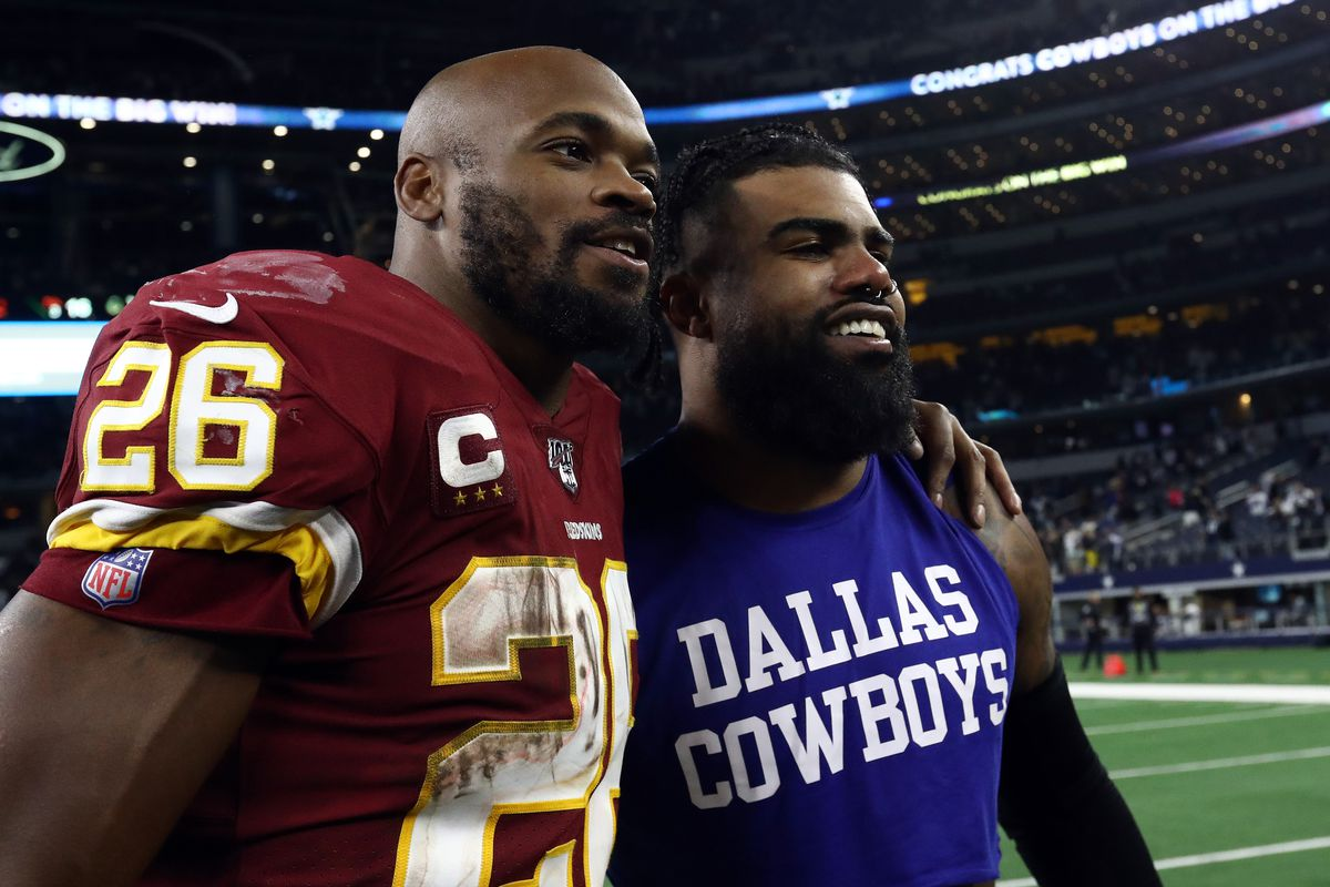ARLINGTON, TEXAS - DECEMBER 29: Adrian Peterson #26 of the Washington Redskins with Ezekiel Elliott #21 of the Dallas Cowboys after the Cowboys defeated the Redskins 47-16 at AT&T Stadium on December 29, 2019 in Arlington, Texas.