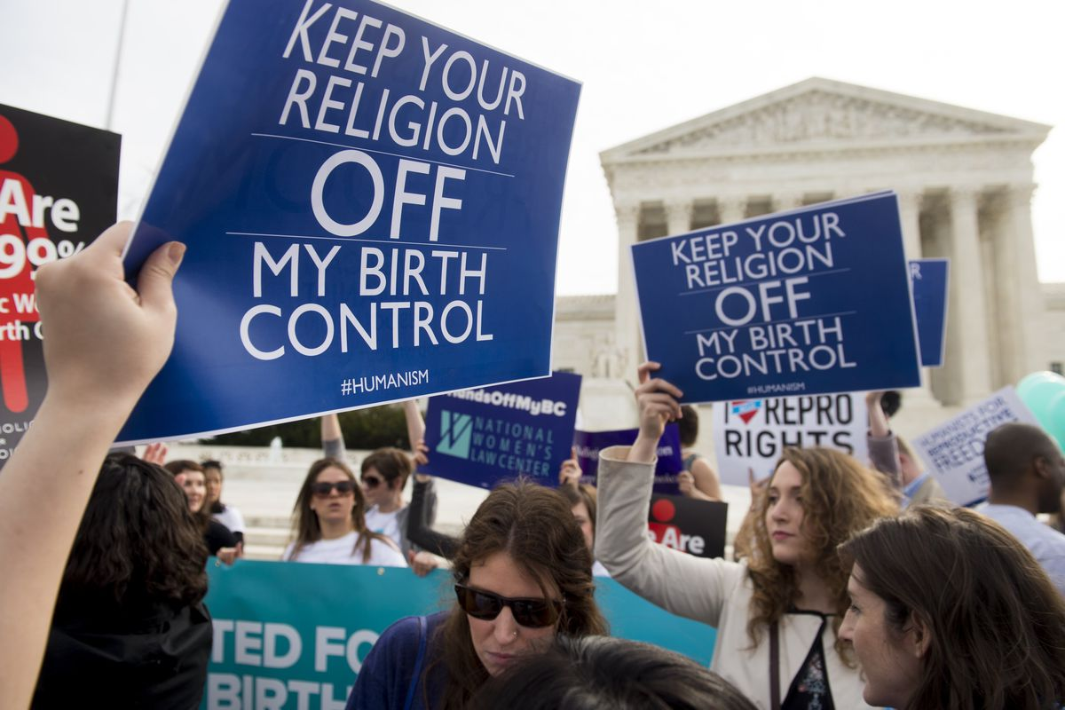 Supporters of birth control access rally outside the Supreme Court in Washington, DC, March 23, 2016